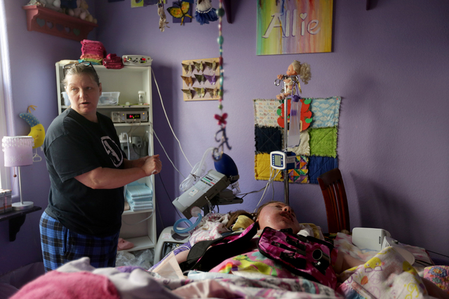 """Sandy Gardner cares for her daughter Allison """"Allie"""" Gardner in their home on Tuesday, Jan. 10, 2017. Allie has spinal muscular atrophy. Make-A-Wish Southern Nevada remodeled a bathroom in the Gar ..."""