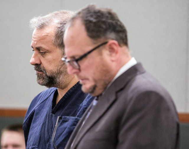 Suspended probate lawyer Robert Graham, left, confers with his attorney Bryan Cox while making his first court appearance at Regional Justice Center on Tuesday, Jan. 10, 2017. He is charged in ste ...