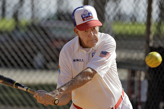 In this Dec. 13, 2016 photo, 97-year-old Winchell Smith takes a swing during a Kids & Kubs softball game in St. Petersburg, Florida. The Kids & Kubs is a Depression Era creation, beginning ...