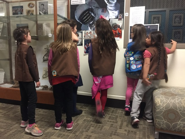 Members of Girl Scouts looking at a wall of female astronauts at the CSN North Las Vegas Campus on Friday, Jan. 13, 2017. (Raven Jackson/Las Vegas Review-Journal) @ravenmjackson