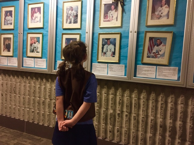 A girl scout looks at a wall of men astronauts at the CSN North Las Vegas Campus on Friday, Jan. 13, 2017. (Raven Jackson/Las Vegas Review-Journal) @ravenmjackson