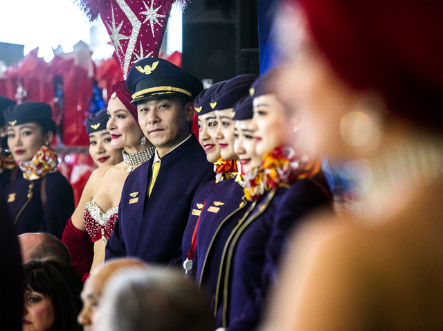 Hainan Airlines flight from Beijing stand for a photos with showgirls  at McCarran International Airport on Friday, Dec. 2, 2016. The first nonstop flight from China arrived on Friday. (Jeff Schei ...
