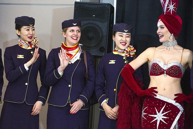 Flight attendants from Hainan Airlines wave during a inaugural flight reception at McCarran International Airport on Friday, Dec. 2, 2016.  Jeff Scheid/Las Vegas Review-Journal Follow @jeffscheid