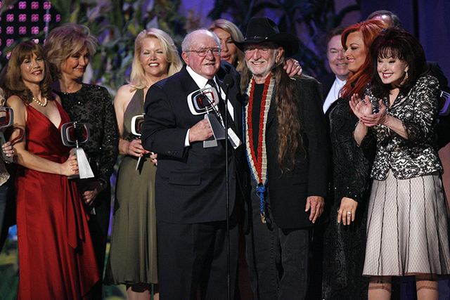 "In this April 14, 2007, file photo, producer Sam Lovullo and singer Willie Nelson, along with the cast of the television show ""Hee Haw"" accept the Entertainer's Award during the 5th Annual TV Land ..."