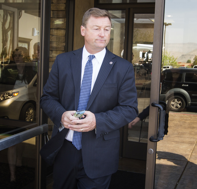 U.S. Sen. Dean Heller, R-Nev., a member of the Senate Veterans Affairs Committee, exits the Corporate Center, 8905 W. Post Road, in Las Vegas, Wednesday, April 1, 2015, following a closed-door mee ...