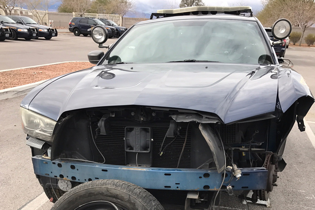 A Nevada Highway Patrol vehicle was damaged when a driver struck the vehicle near the 215 Beltway and Summerlin Parkway, Tuesday night, Jan. 3, 2017. (Jason Buratczuk/Nevada Highway Patrol)