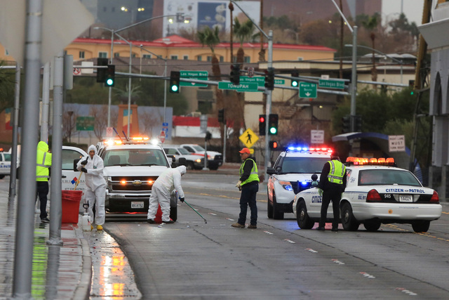 North Las Vegas police work the scene of a critical injury hit-and-run just south of Lake Mead Boulevard on Las Vegas Boulevard North in North Las Vegas on Friday, Jan. 13, 2017. (Brett Le Blanc/L ...
