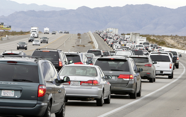 Traffic is building on southbound Interstate 15 near Jean as holiday travelers leave Las Vegas, mostly returning to South California after the New Year's weekend, Monday, Jan. 2, 2017. (Bizuayehu  ...