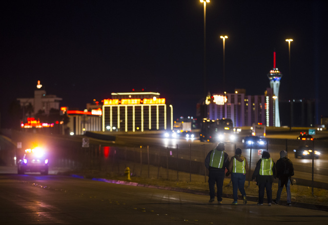 Volunteers and Las Vegas police search for homeless people along A Street during the Southern Nevada Homeless Census in downtown Las Vegas on Tuesday, Jan. 24, 2017. (Chase Stevens/Las Vegas Revie ...