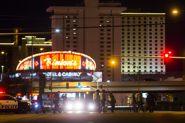Volunteers and Las Vegas police search for homeless people along Bonanza Road during the Southern Nevada Homeless Census in downtown Las Vegas on Wednesday, Jan. 25, 2017. (Chase Stevens/Las Vegas ...