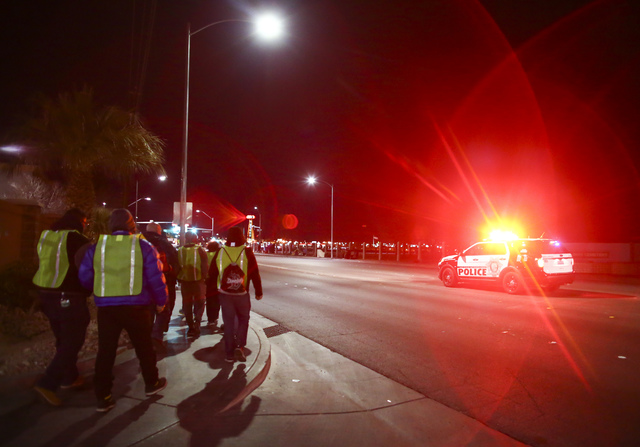 Volunteers and Las Vegas police search for homeless people along Las Vegas Boulevard during the Southern Nevada Homeless Census in downtown Las Vegas on Tuesday, Jan. 24, 2017. (Chase Stevens/Las  ...