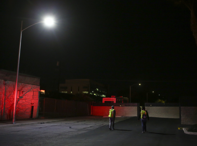 Volunteers and Las Vegas police search for homeless people along Las Vegas Boulevard during the Southern Nevada Homeless Census in downtown Las Vegas on Wednesday, Jan. 25, 2017. (Chase Stevens/La ...