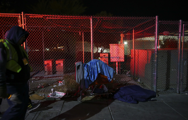 Volunteers and Las Vegas police search for homeless people along Foremaster Lane during the Southern Nevada Homeless Census in downtown Las Vegas on Tuesday, Jan. 24, 2017. (Chase Stevens/Las Vega ...