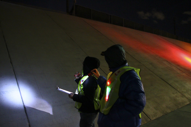 Volunteers search for homeless people near an underpass along Washington Avenue during the Southern Nevada Homeless Census in downtown Las Vegas on Tuesday, Jan. 24, 2017. (Chase Stevens/Las Vegas ...