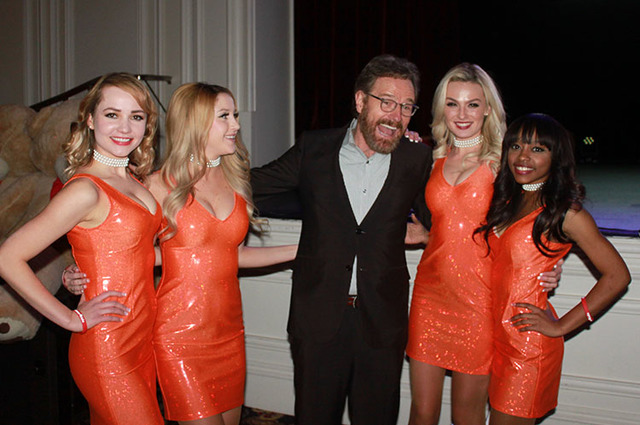 Bryan Cranston poses with the Hooters Girls (from left, Alina Tesla, Brandi Brennan, Bryan Cranston, Kristin Morris and Lynn Blake) during the Canon USA National Center for Missing and Exploited C ...