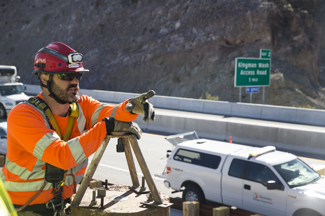 Ryan Nataluk, bridge and structure inspection manager with Stantec, speaks on the inspection progress of the Mike O'Callaghan-Pat Tillman Memorial Bridge at the Hoover Dam, Tuesday, Jan. 31, 2017. ...