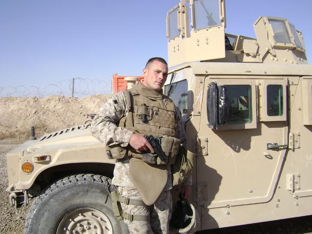 Marine Matt Shepard stands by his patrol vehicle in Anbar province, Iraq in 2007. (Courtesy Matt Shepard)
