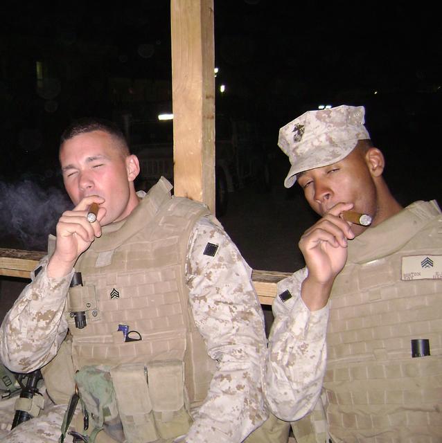Marine Matt Shepard, left, and an unidentified Marine smoke cigars to celebrate the Marine Corps birthday, Nov 10, 2007, in Iraq. (Courtesy Matt Shepard)