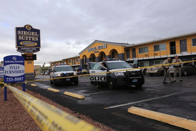 Las Vegas police work the scene of a shooting at a Siegel Suites at 455 E. Twain Ave. in Las Vegas on Friday, Jan. 13, 2016. (Brett Le Blanc/Las Vegas Review-Journal) @bleblancphoto