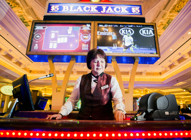 Mirjana Lekic deals cards at the Stadium Blackjack area in The Venetian on Wednesday, Jan, 25, 2017. The casino is testing the new Scientific Game which multiple players compete separately against ...