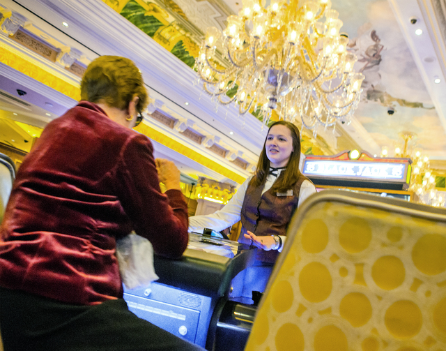 Blackjack dealer Renee Mitchell answers a player's questions about Stadium Blackjack area at The Venetian on Wednesday, Jan, 25, 2017. The casino is testing the new Scientific Game which multiple  ...