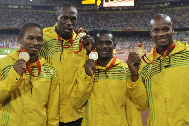 Jamaica's men's 4x100 meters relay team, from left, Michael Fraser, Usain Bolt, Nesta Carter and Asafa Powell, show their gold medals during the athletics competitions in the National Stadium at t ...