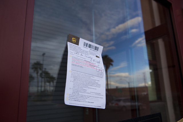 A note hangs in front of Jared, a jewelry store where employee Kimberlee Ann Kincaid-Hill died after being accidentally shot by a security guard during an armed robbery at the store in Henderson o ...