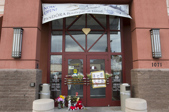 A memorial display in front of Jared, a jewelry store where employee Kimberlee Ann Kincaid-Hill died after being accidentally shot by a security guard during an armed robbery at the store in Hende ...