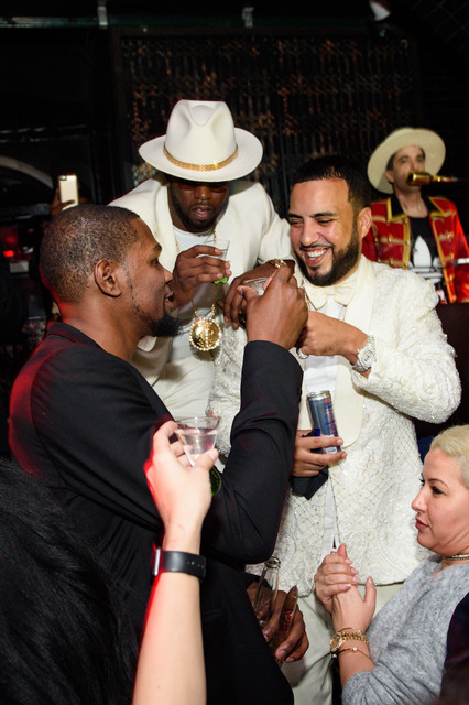 A New Years' Eve triple-double at Lavo at Palazzo, starring, from left, Kevin Durant, Diddy and French Montana. (Al Powers photo)