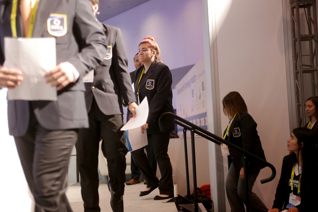 Students from the Basic Academy of International Studies walk on stage at the Consumer Technology Association Student Business Pitch Competition on Sunday, Jan. 8, 2016, at the Consumer Electronic ...