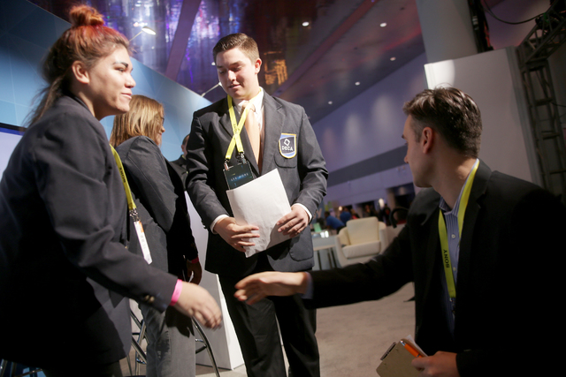 Judge Frank Gruber shakes hands with students after they delivered a business pitch at the Consumer Technology Association Student Business Pitch Competition on Sunday, Jan. 8, 2016, at the Consum ...