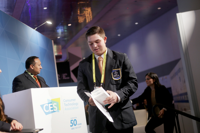 """Student Christopher """"CJ"""" Dornak walks away with his first place prize at the Consumer Technology Association Student Business Pitch Competition on Sunday, Jan. 8, 2016, at the Co ..."""