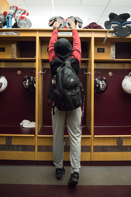 Rickey Nichols, cousin and roommate of fallen Missouri State football player Richard Nelson, puts Nelson's shoulder pads on his locker in Springfield on Tuesday, Jan. 17, 2016. (Ryan Welch for Las ...