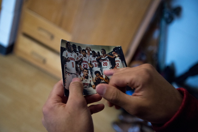 Rickey Nichols, cousin and roommate of fallen Missouri State football player Richard Nelson, shows Nelson's photo from Chaparral High School in their dorm room on campus in Springfield on Tuesday, ...