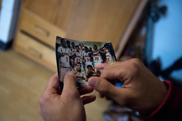 Rickey Nichols, cousin and roommate of fallen Missouri State football player Richard Nelson, shows Nelson's photo from Chaparral High School, in their dorm room on campus in Springfield on Tuesday ...