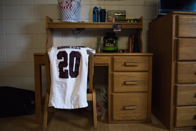 Richard Nelson's football jersey at his dorm room desk at Missouri State University in Springfield on Tuesday, Jan. 17, 2016. The jersey was placed by Nelson's cousin and roommate Rickey Nichols.  ...