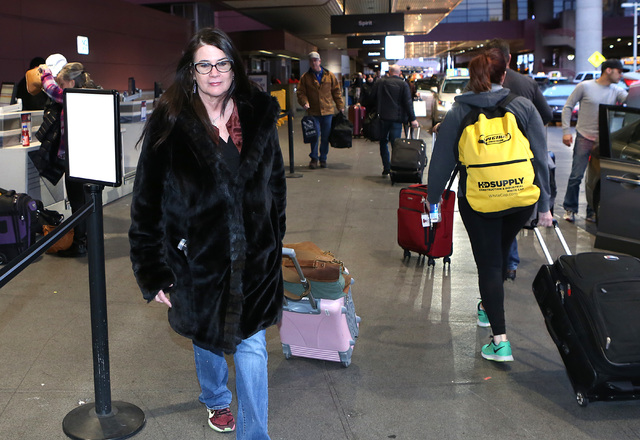 Claudia Keelan arrives at McCarran International Airport on Thursday, Jan. 19, 2017, in Las Vegas. Keelan departs for  District of Columbia to participate in the Women's March in Washington. (Bizu ...