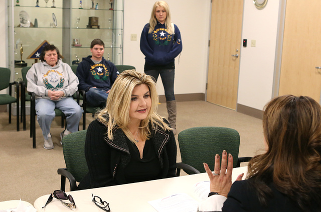 LuAnn Holmes, Las Vegas City clerk, right, discusses about the 2017 Municipal Election Candidate's Guide with former Nevada Assemblywoman Michele Fiore after Fiore files her paperwork to run for L ...