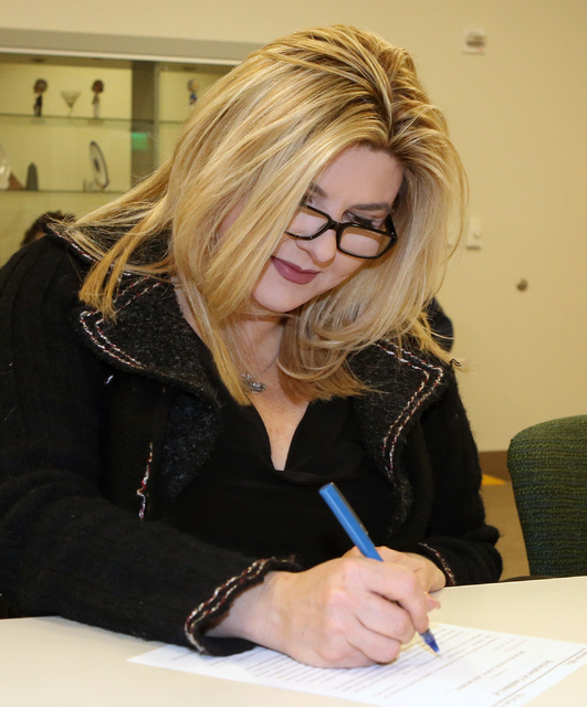 Former Nevada Assemblywoman Michele Fiore signs her Declaration of Candidacy to represent Ward 6 on the City Council on Tuesday, Jan. 24, 2017, at Las Vegas City Hall. (Bizuayehu Tesfaye/Las Vegas ...