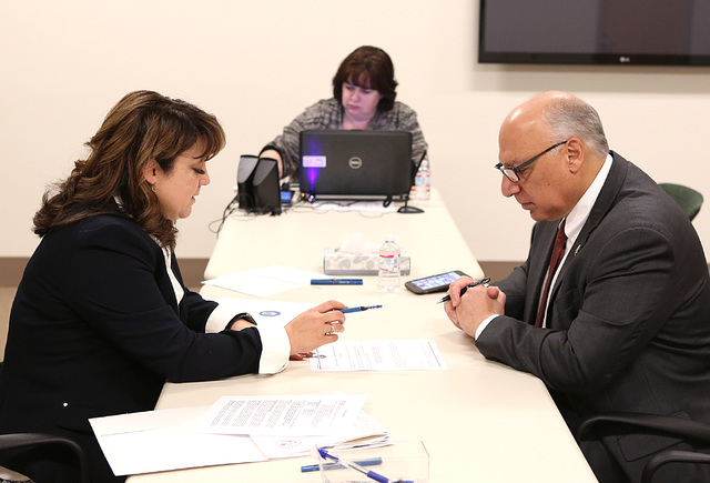 LuAnn Holmes, Las Vegas City clerk, left, discusses about the 2017 Municipal Election Candidate's Guide with Ward 4 Councilman Stavros Anthony after Antony files his paperwork to run for Las Vegas ...