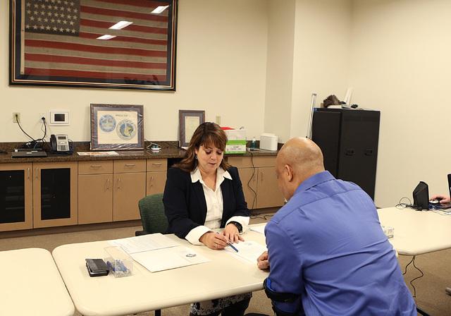 LuAnn Holmes, Las Vegas City clerk, left, discusses about the 2017 Municipal Election Candidate's Guide with Allen Jordan after Jordan files his paperwork to run for Las Vegas City Council represe ...