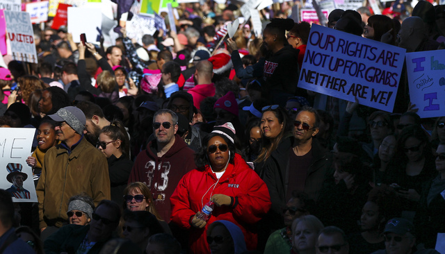 Demonstrators march for women's rights outside of the Lloyd George U.S. Courthouse in downtown Las Vegas on Saturday, Jan. 21, 2017. (Chase Stevens/Las Vegas Review-Journal) @csstevensphoto