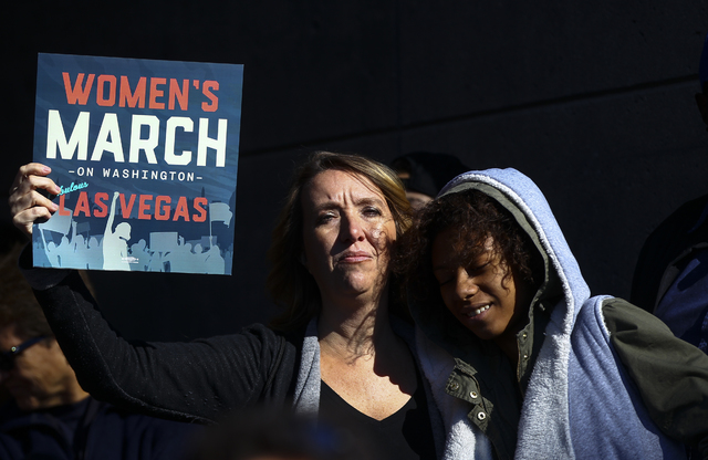 Demonstrators gather for women's rights outside of the Lloyd George U.S. Courthouse in downtown Las Vegas on Saturday, Jan. 21, 2017. (Chase Stevens/Las Vegas Review-Journal) @csstevensphoto