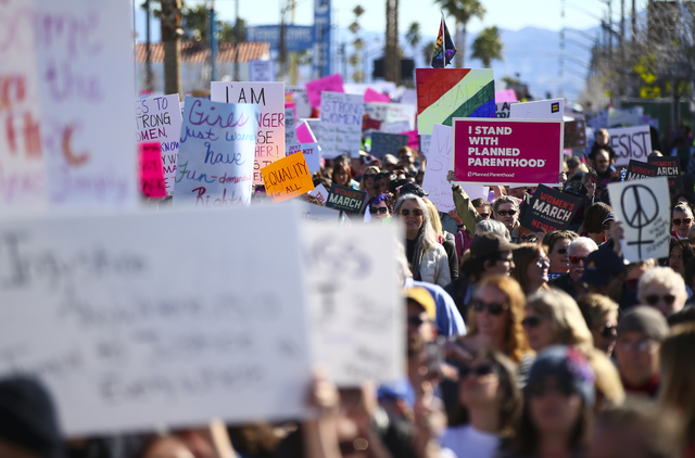 Demonstrators march along Fremont Street for women's rights in downtown Las Vegas on Saturday, Jan. 21, 2017. (Chase Stevens/Las Vegas Review-Journal) @csstevensphoto
