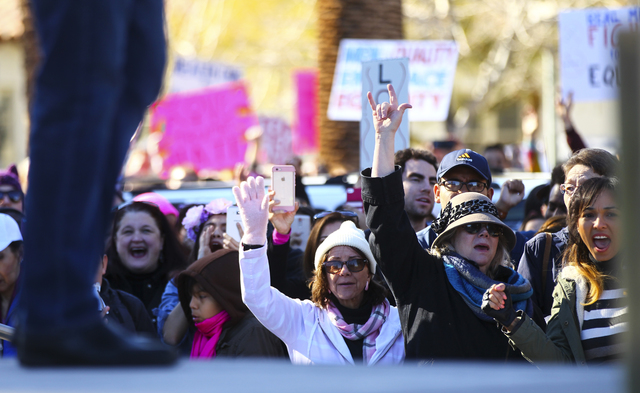 Demonstrators cheer as U.S. Rep. Ruben Kihuen, D-Nev., speaks in support of women's rights outside of the Lloyd George U.S. Courthouse in downtown Las Vegas on Saturday, Jan. 21, 2017. (Chase Stev ...