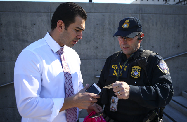 A Department of Homeland Security police officer moves U.S. Rep. Ruben Kihuen, D-Nev., off of the steps of Lloyd George U.S. Courthouse for failing to produce his Congressional ID as demonstrators ...
