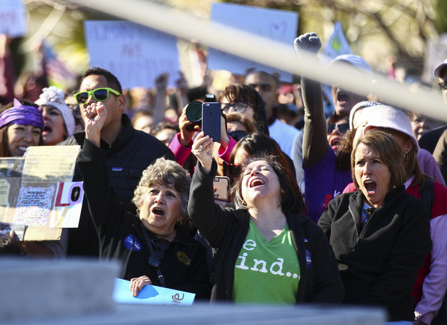 Demonstrators cheer for women's rights outside of the Lloyd George U.S. Courthouse in downtown Las Vegas on Saturday, Jan. 21, 2017. (Chase Stevens/Las Vegas Review-Journal) @csstevensphoto