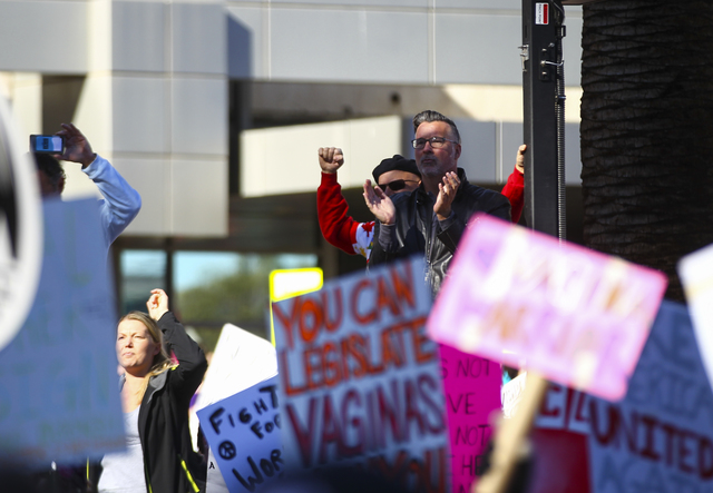 Supporters of women's rights gather outside of the Lloyd George U.S. Courthouse in downtown Las Vegas on Saturday, Jan. 21, 2017. (Chase Stevens/Las Vegas Review-Journal) @csstevensphoto