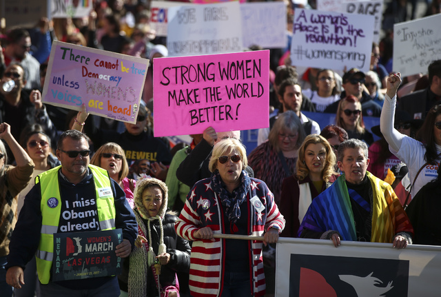 Roberta Lange, chairwoman of the Nevada State Democratic Party, center, marches with demonstrators for women's rights in downtown Las Vegas on Saturday, Jan. 21, 2017. (Chase Stevens/Las Vegas Rev ...
