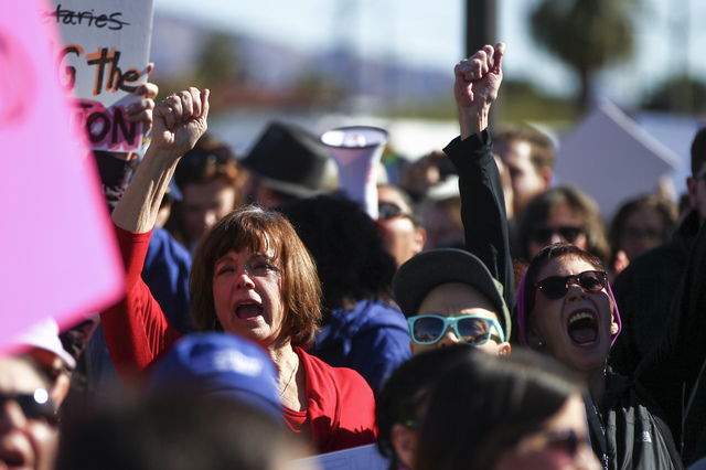 Demonstrators gather to march for women's rights in downtown Las Vegas on Saturday, Jan. 21, 2017. (Chase Stevens/Las Vegas Review-Journal) @csstevensphoto